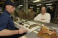 US Navy 060419-N-2568S-139 Machinery Repairman 1st Class Robert Mims describes to Secretary of the Navy (SECNAV) the Honorable, Dr. Donald C. Winter several types of work the machine shop is capable of producing.jpg