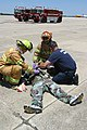 US Navy 060518-N-0856O-728 Naval Air Station (NAS) Pensacola firefighter and emergency medical technicians assist a victim following a mock crash of the Navy Flight Demonstration Team Blue Angels.jpg