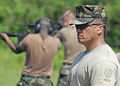 US Navy 060830-N-9662L-013 Petty Officer 1st Class Michael Kokkeby observes Sailors during a M16A1 qualification at the Naval Base Guam gun range.jpg