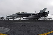 """US Navy 061213-N-8158F-025 An F-A-18F Super Hornet assigned to the """"Black Aces"""" of Strike Fighter Squadron Four One (VFA-41) launches from the flight deck aboard the nuclear-powered aircraft carrier USS Nimitz (CVN 68)"""