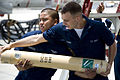 US Navy 070430-N-8937A-006 Aviation Electronics Technician 3rd Class Anthony Danno takes a sonobuoy from Aviation Structural Mechanic 3rd Class Ferdinand Mendoza during a timed sonobuoy loading evolution.jpg