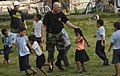 US Navy 070622-N-6278K-008 Air Force Tech. Sgt. Michael Cooper, a member of Construction Battalion Maintenance Unit (CBMU) 202, plays with children at Monsignor Romero Roman Catholic School in the Valley of Peace.jpg