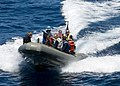US Navy 070817-N-0483B-001 Sailors aboard amphibious command ship USS Blue Ridge (LCC 19) conduct small boat training with a ridged hull inflatable boat while underway in the western Pacific.jpg