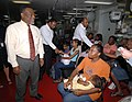 US Navy 070928-N-7088A-092 Guyana's Prime Minister Samuel Hinds speaks with patients waiting to be seen by medical personnel aboard Military Sealift Command hospital ship USNS Comfort (T-AH 20).jpg