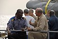 US Navy 071104-N-0193M-104 Lt. A.S. Omotosho, a Nigerian navy officer embarked with Africa Partnership Station (APS), talks with Cmdr. Martin Pompeo, commanding officer of USS Fort McHenry (LSD 43), during a steel beach picnic.jpg