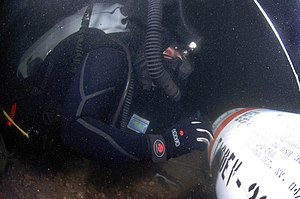 Clearance diver - Preparing to raise a mine from the seabed