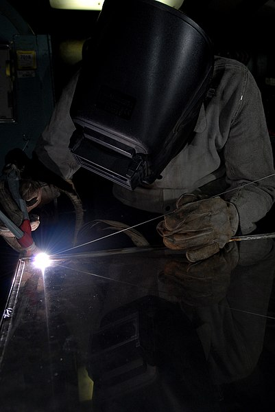File:US Navy 080809-N-7730P-060 Hull Maintenance Technician (HT) 3rd class Joe Vanhorn brazes a shelf to go in a supply storeroom aboard the Nimitz-class aircraft carrier USS Ronald Reagan (CVN 76).jpg