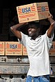 US Navy 080916-N-3595W-055 A Port-au-Prince citizen carries supplies to be delivered to communities affected by Hurricane Ike.jpg
