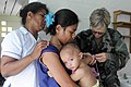 US Navy 090829-N-9689V-005 Navy pediatrician Capt. Tamara Grigsby treats an infant during a Pacific Partnership 2009 medical civic action project.jpg