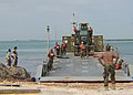 US Navy 100131-N-9643W-373 Seabees assigned to Amphibious Construction Battalion (ACB) 2 off-load an Improved Navy Lighterage System causeway at a beach in Port-au-Prince, Haiti.jpg
