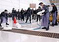 US Navy 100217-8490W-N-003 Power plants department Sailors assigned to the Mad Foxes of Patrol Squadron (VP) 5 simulate an oil spill in Hangar 511 during the squadron's maintenance Olympics.jpg