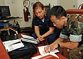 US Navy 100217-N-6676S-012 Lt. Brandon Le takes notes as Chief Warrant Officer 3 Eve McAnallen instructs him on advanced French.jpg