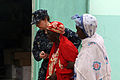 US Navy 100419-M-0000T-002 Lt. Cmdr. Karen Corson, medical liaison officer for Africa Partnership Station (APS) West, escorts a Senegalese woman during a medical outreach project.jpg