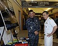 US Navy 100514-N-6686P-182 Master-at-Arms 2nd Class Jerry M. Bonham discusses the security department's drunk driving awareness display with Vice Adm. Harry Harris.jpg