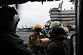 US Navy 110321-N-2653B-062 Sailors aboard the aircraft carrier USS Ronald Reagan (CVN 76) load supplies onto an SH-60F Sea Hawk helicopter from the.jpg