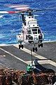 US Navy 110409-N-1004S-438 Chief Logistics Specialist Adriana Cabarcas, from Gary, Ind., attempts to connect a cargo pendant to an SA-330 Puma heli.jpg
