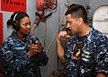 US Navy 110908-N-BK435-004 Ensign John Araiza, right, trains Interior Communications Electrician Fireman Breaune Sajna during a damage control dril.jpg