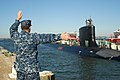 US Navy 111021-N-NK458-077 Chief Electronics Technician Sean Patrick, pier master for Commander, Submarine Squadron 6, signals to direct the arriv.jpg