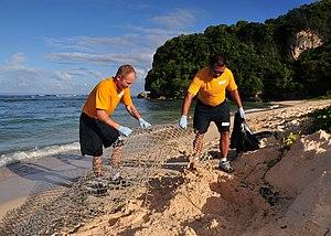 US Navy 111209-N-BT122-263 Sailors remove trash from the beach.jpg