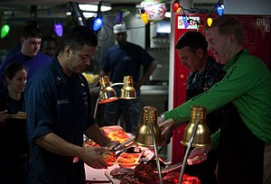 US Navy 111225-N-DR144-066 Capt. Kent D. Whalen, the commanding officer aboard the Nimitz-class aircraft carrier USS Carl Vinson (CVN 70), serves M.jpg