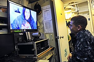 US Navy 120209-N-ZZ999-084 Engineman 3rd Class Brandon Doxtator sees his newborn daughter for the first time during a video teleconference aboard t.jpg