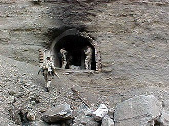 United States Navy SEALs - Task Force K-Bar SEALs at one of the entrances to the Zhawar Kili cave complex