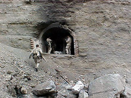 Navy SEALs at one of the entrances to the Zhawar Kili cave complex US Navy SEALs at Zhawar Kili cave entrance.jpg