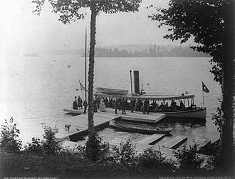 "Raquette Lake - Small steamers brought guests from Blue Mountain Lake via the Eckford Chain of Lakes and the Marion River Carry.  ""Under the hemlocks"" - Raquette Lake, 1888, S R Stoddard"