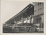Under the southern approach of Sydney Harbour Bridge, 1928 (8283745874).jpg