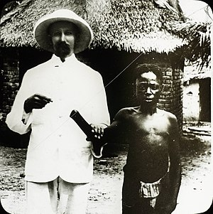 Belgian overseas colonies - A white missionary posing with Congolese man, mutilated by the Congo Free State government