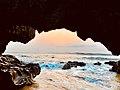 View of Sunrise through Natural Arch near Thotlakonda.jpg