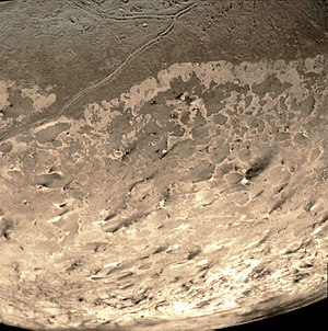 Triton Hopper - Dark streaks across Triton's south polar cap surface, thought to be dust deposits left by eruptions of nitrogen geysers