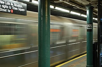145th Street (IRT Lenox Avenue Line) - A 3 train speeds by the platforms of 145th Street station, before the 2018 renovations