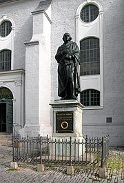 The Johann Gottfried Herder statue in Weimar in front of the Peter and Paul church