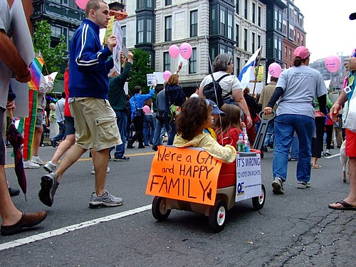 Boston gay pride march, held annually in June. Massachusetts became the first U.S. state to legalize same-sex marriage in 2004. Were a gay and happy family wagon.jpg