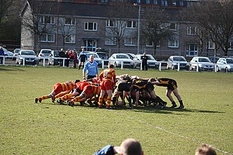 West of Scotland F.C. - West of Scotland FC (in red and yellow) scrum
