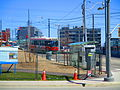 Westbound streetcar approaches, River and King, 2016 04 16 (1) (26311815050).jpg