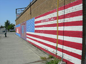 White Center, Washington - U.S. and Cambodian flags on the side of the New Angkor Market