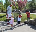 Williams and children on the court (9035101683).jpg