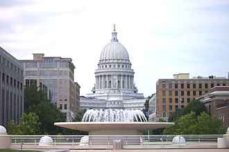 Monona Terrace - View of the Wisconsin State Capitol building overlooking Monona Terrace and the water fountain