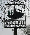 Sign in Woolpit depicting the two green children