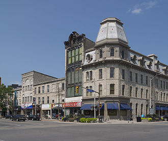 "Downtown Guelph - Intersection of Wyndham and Macdonell streets in Downtown Guelph.  The Petrie Building built in 1882 is visible (with red ""Restaurant"" sign) ."