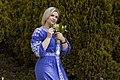 День Вишиванки. Молода україночка у вишитій синій сукні серед квітів 25.jpg