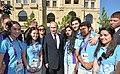 Путин с волонтёрами I Европейских игр в Баку.jpg