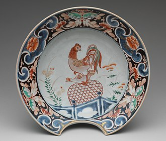Economy of Japan - Japanese export porcelain in the European shape of a barber's basin, with copulating cock, around 1700.