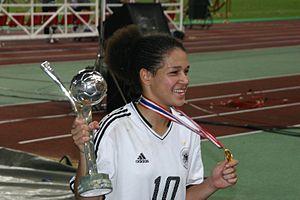 Célia Šašić - Šašić with the FIFA U-19 (now U-20) Women's World Cup trophy