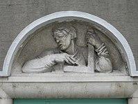 1100 Laxenburger Straße 203-217 Stg. 5 - Natursteinrelief Arbeiter von Josef Riedl IMG 7420.jpg