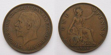 Both sides of an old, large British penny dated 1936