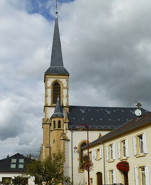 Church of Kuntzig, side view. Moselle department. Note the white painting (absent in the 2011 picture).