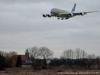 Neuenfelde - An A380 landing at Finkenwerder airport, with the local church below